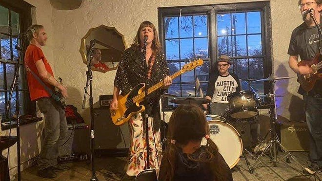 """Erin Walter, center, plays """"The World's On Fire (And We Still Fall in Love)"""" with her band, Parker Woodland, at Batch Craft Beer & Kolaches in January. It was the band's last show before the pandemic."""