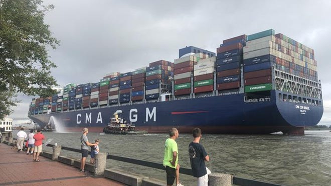 Onlookers watch the CMA CGM Brazil make its way up the Savannah River to the Port of Savannah Friday morning. At 1,200 feet long and 167 feet wide the  CMA CGM Brazil  is the largest vessel to ever call on the Port of Savannah.