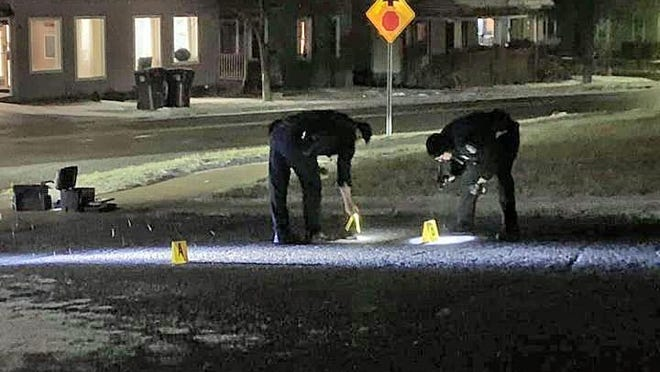 Hillsdale City Police officers process evidence in an alley near the Hillsdale Community Library where shell casings were found after a shooting Tuesday night.