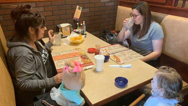 Customers enjoy dine-in lunch Tuesday at El Cerritos in Hillsdale for the first time in months.
