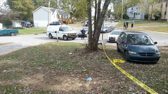 Jonathan Corke's belongings in the yard of McCormick's neighbor, while police investigated the area on Nov. 3.
