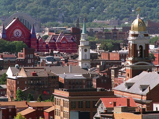 Text: 1999.0913.11.4 GERMANTOUR-TEMPO: Cincinnati Music Hall, left, Old St. Mary's Church, center, and old St. Paul's Church, right, soar up over the rooftops of Over-the-Rhine. All three buildings as well as much of Over-the-Rhine show the influence of Cincinnati's German Heritage. Photo by Glenn Hartong/The Cincinnati Enquirer. gh.