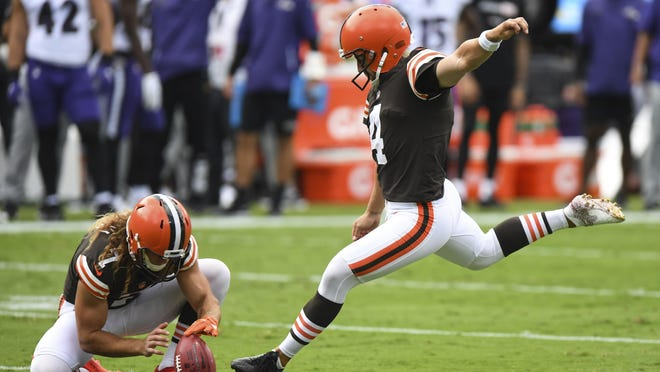 Cleveland Browns place kicker Austin Seibert (4) attempts extra point in the first half during an NFL football game against the Baltimore Ravens, Sunday, Sept. 13, 2020, in Baltimore.