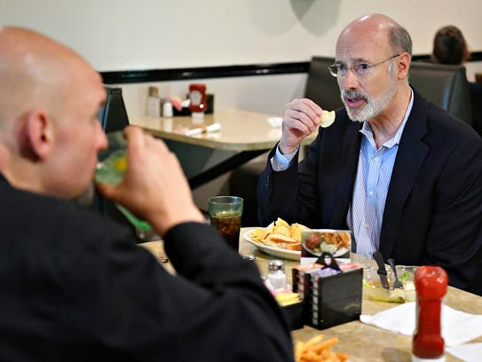 Gov. Tom Wolf, right, and newly elected Lt. Gov. running
