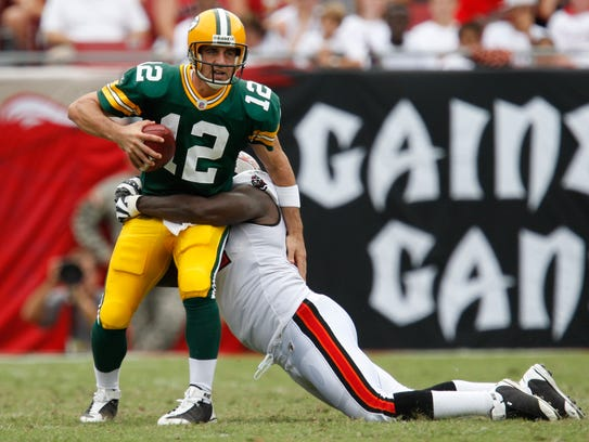 Packers quarterback Aaron Rodgers is sacked during