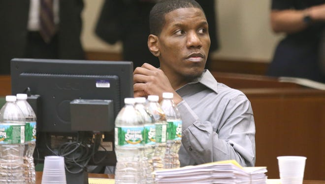 Thomas Johnson lll listens during the closing arguments in his murder trial on May 6, 2015.