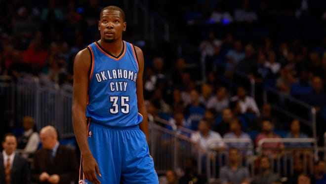 Kevin Durant looks on against the Orlando Magic during the first quarter at Amway Center.