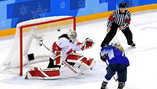 United States forward Monique Lamoureux-Morando (7) scores a goal against Canada goaltender Shannon Szabados (1) in the third period in the gold-medal game.