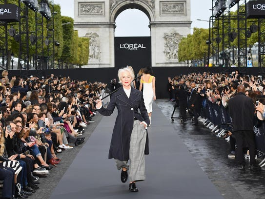 Helen Mirren, 72, walks the runway during Le Defile
