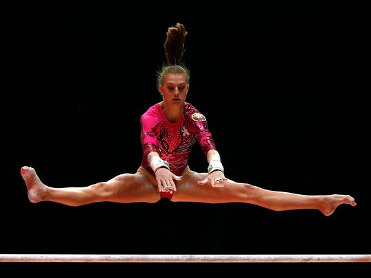 Kylie Dickson from Belarus performs on the uneven bars