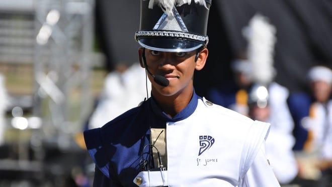 Senior Mikal Webb serves as one of the two Drum Majors for Saint James.