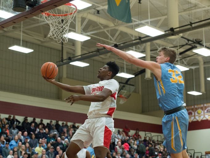 Smyrna's Jaymeir Garnett (5) goes up for a layup during