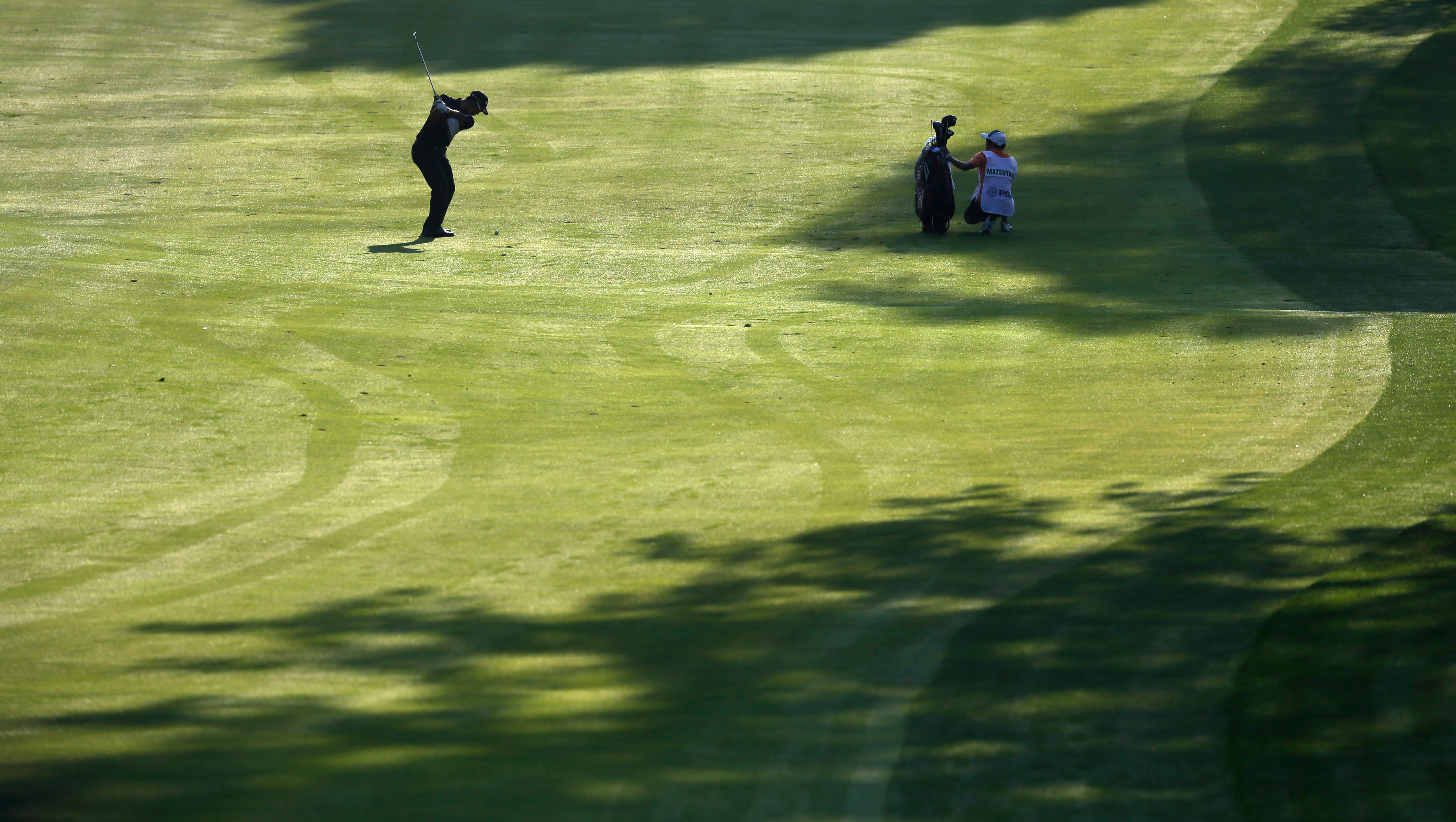 Hideki Matsuyama hits from the 10th fairway during the first round of the PGA Championship golf tournament at Oak Hill Country Club.