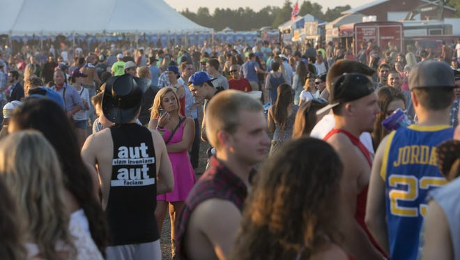Ford Festival Park fills with people June 27, 2015, to see the Saturday night performances during Country USA.