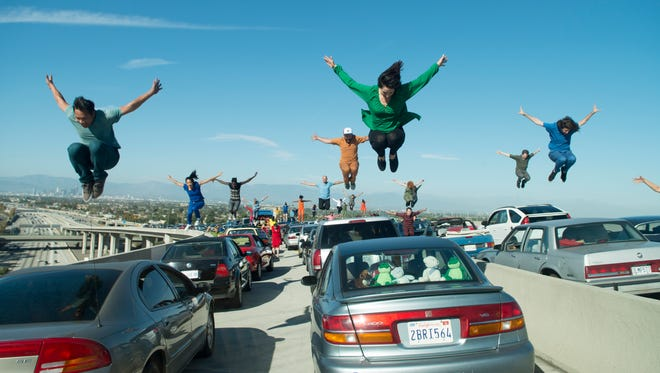 'La La Land' dancers leap in unison while filming the opening number, 'Another Day of Sun.'