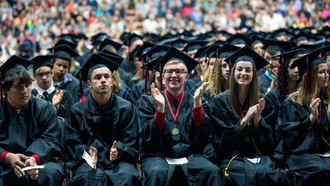 Graduates clap for student speakers during Stevens Point Area Senior High's graduation ceremony in Stevens Point, Wis., May 27, 2018.