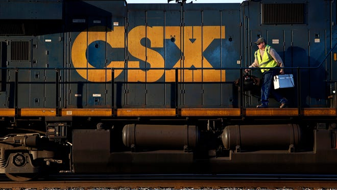 A crew member walks on a CSX freight train engine in Brunswick, Md. Canadian Pacific Railway on Monday, Oct. 20, 2014 said it has ended talks with U.S. counterpart CSX about a possible combination and plans no more discussions. (AP Photo/Patrick Semansky, File) ORG XMIT: NYBZ142