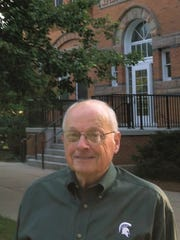 """MSU retiree Stephen Terry of Williamston wrote """"Michigan Agricultural College Campus Life 1900-1925: A Postcard Tour,"""" which made the state's 2015 list of Notable Books."""