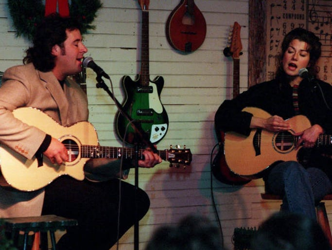 Country music singer Vince Gill and Amy Grant entertain Mini-Vinny volunteers at Green's Grocery on Monday.