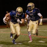 Junior Chris Bergin (left) and senior Kone Bowman helped lead Country Day to a 70-6 triumph over Cesar Chavez Academy.