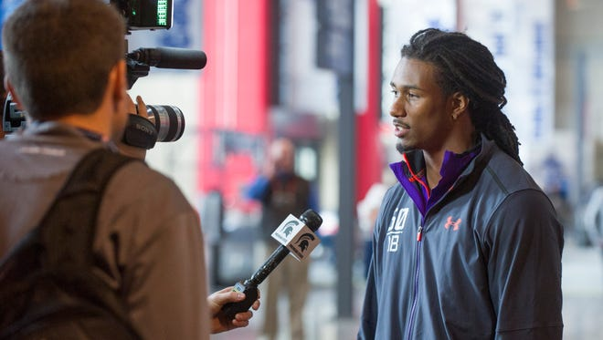 Michigan State defensive back Trae Waynes talks with a TV crew at the NFL football scouting combine at Lucas Oil Stadium in Indianapolis, Saturday, Feb. 21, 2015.