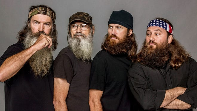 """This undated image released by A&E, shows The Robertsons, from left, Phil, Si, Jase and Willie, from the reality series, """"Duck Dynasty."""" The Las Vegas show """"Duck Commander Musical,"""" based on the popular series, premiered Wednesday, April 15, at the Rio All-Suites Hotel & Casino and tells the story of a family duck-call business that led to reality show juggernaut """"Duck Dynasty."""""""