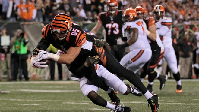 Cincinnati Bengals tight end Tyler Eifert (85) drives across the goal line for the first touchdown of the game in the first quarter of the NFL Week 9 game between the Cincinnati Bengals and the Cleveland Browns at Paul Brown Stadium in downtown Cincinnati on Thursday, Nov. 5, 2015.