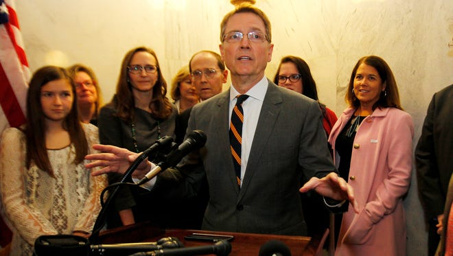 Lexington Mayor Jim Gray (C) addresses the media after filing today to challenge U.S. Sen. Rand Paul in the 2016 election, filling a hole on the Democratic ticket left vacant when former state Auditor Adam Edelen at the State Capital in Frankfort, Kentucky.       January 26, 2016.