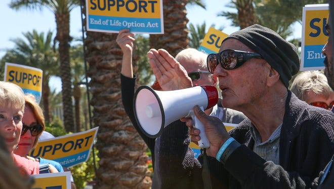 Dr. Wayne McKinny speaks to supporters of the End Of Life Option Act during a protest in front of Eisenhower Medical Center in Rancho Mirage in March  2017.