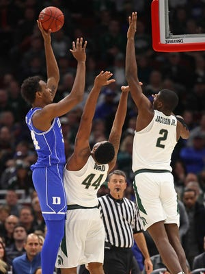 Wendell Carter Jr #34 of the Duke Blue Devils shoots over Nick Ward #44 and Jaren Jackson Jr. #2 of the Michigan State Spartans during the State Farm Champions Classic at the United Center on November 14, 2017 in Chicago, Illinois.