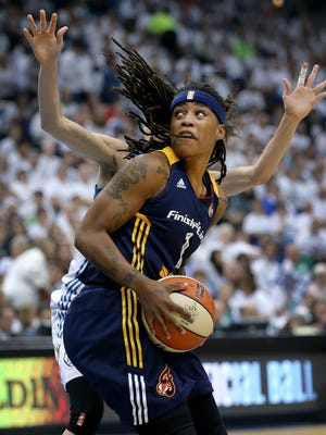 Indiana Fever guard Shavonte Zellous (1) spins around Minnesota Lynx guard Anna Cruz (51) in the first half of their game. The Indiana Fever lost to the Minnesota Lynx 52-69 in Game #5 of the WNBA Finals Wednesday, October 14, 2015, evening at Target Center in Minneapolis MN.