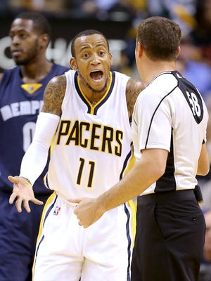 Indiana Pacers guard Monta Ellis (11) argues with official Josh Tiven,right,  in the first half of their game. The Indiana Pacers play the Memphis Grizzlies in their home opener Thursday, October 29, 2015, at Bankers Life Fieldhouse.