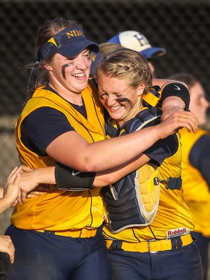 Pitcher Haylee Smith and catcher Kennedy Baugh celebrate their 5-4 win.