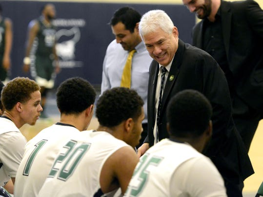 PSC basketball coach Pete Pena celebrates 100 wins