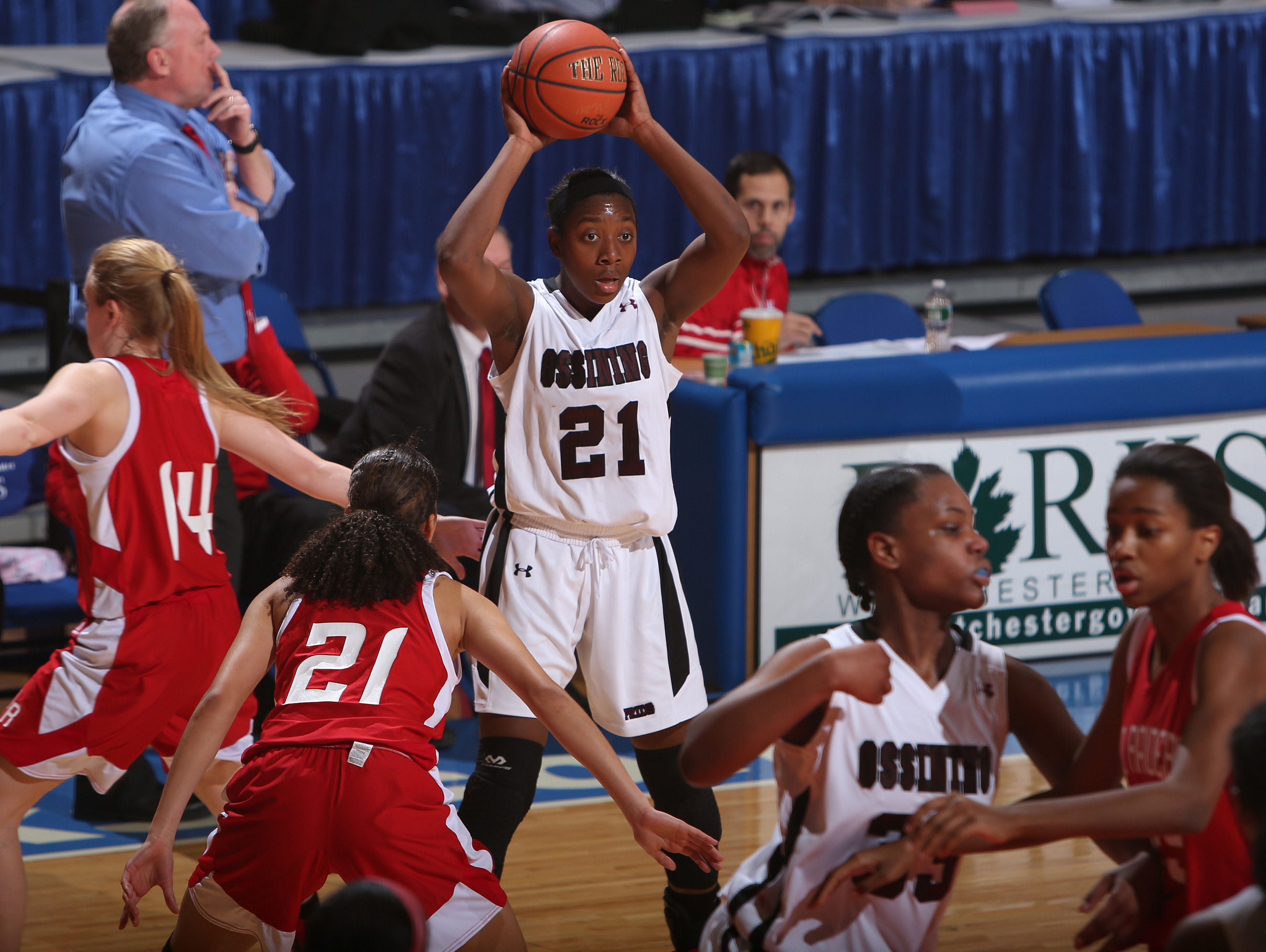 Ossining's Shadeen Samuels (21) looks for an open teammate against North Rockland during the girls basketball Section 1 Class AA semifinal at the Westchester County Center in White Plains Feb. 26, 2015.