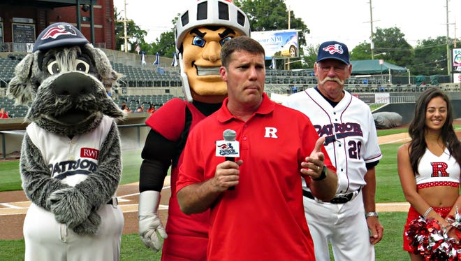 Rutgers University football coach Chris Ash addresses the crowd at TD Bank Ballpark, with Sparkee the mascot, Patriots manager emeritus Sparky Lyle, the Scarlet Knight mascot and a cheerleader.