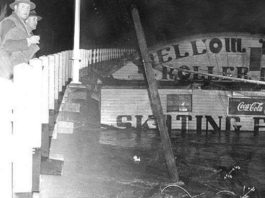 Mellow Moon Skating Rink is seen against the bridge during January 1943 flood.
