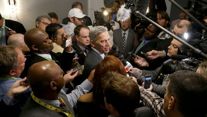 NFL vice president Eric Grubman, center, speaks to reporters during the NFL's spring meetings in San Francisco, Wednesday, May 20, 2015. Grubman is the league's lead man on a possible return to Los Angeles. (AP Photo/Jeff Chiu)