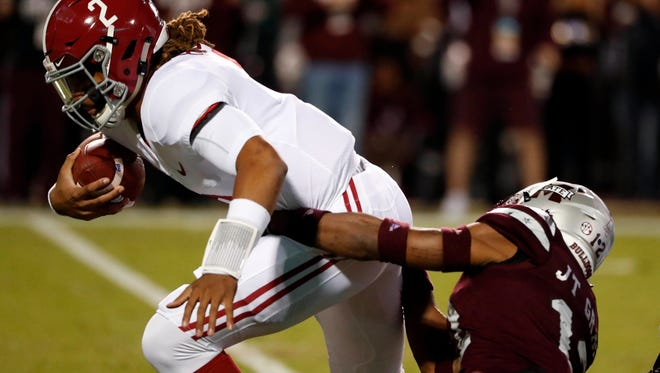 Alabama quarterback Jalen Hurts (2) is sacked by Mississippi State defensive back J.T. Gray (12) during the first half of an NCAA college football game in Starkville, Miss., Saturday, Nov. 11, 2017. (AP Photo/Rogelio V. Solis)