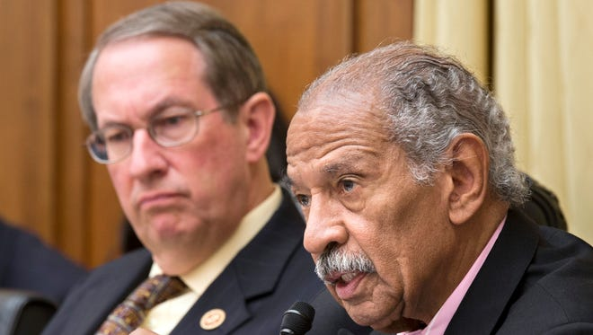 Rep. John Conyers of Michigan, the top Democrat on the House Judiciary Committee, right, and Chairman Bob Goodlatte, R-Va.