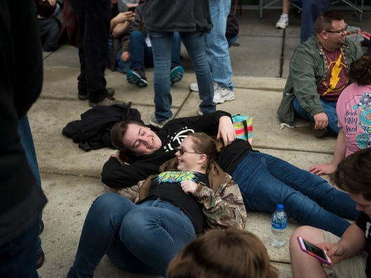 Cameron McKnight, 16, and Courtney Bayer, 16, lay down as they wait in line for the Winter Jam Tour concert outside the Ford Center on Thursday, Feb. 15, 2018. The Winter Jam Tour is a christian music concert series with $15 first come, first serve tickets.