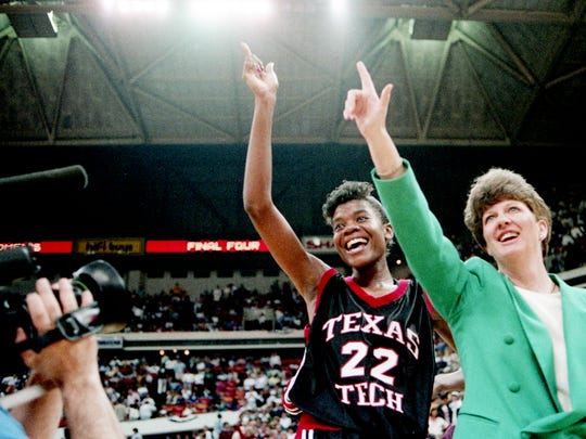 Texas Tech Player of the Year Sheryl Swoopes (22) and head coach Marsha Sharp signal to their fans after defeating the No. 1 ranked Vanderbilt 60-46 in the NCAA Final Four semifinal game at the Omni in Atlanta April 3, 1993.