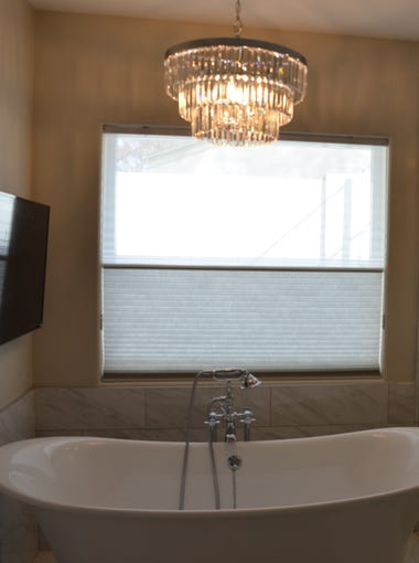 The Diamonds built a new master suite, which includes a master bath complete with an oversized shower, a stand-alone tub, a flat-screen TV and the same light fixture seen throughout the rest of the home.