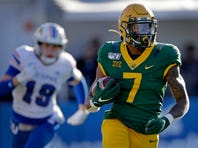Baylor quarterback Charlie Brewer passes the ball during the first half of an NCAA college football game against Kansas, Saturday, Nov. 30, 2019, in Lawrence, Kan. (AP Photo/Charlie Riedel)