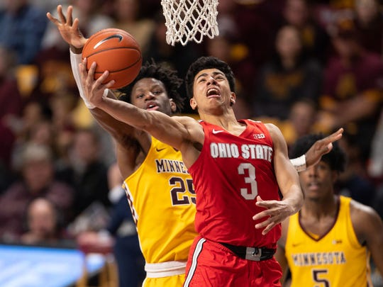 Dec 15, 2019; Minneapolis, MN, USA; Ohio State Buckeyes guard D.J. Carton (3) drives to the basket as Minnesota Gophers center Daniel Oturu (25) guards him during the second half at Williams Arena. Mandatory Credit: Harrison Barden-USA TODAY Sports