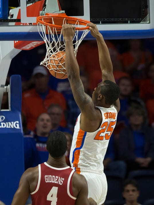 Florida forward Keith Stone (25) dunks over Alabama forward Daniel Giddens (4) during the first half of an NCAA college basketball game in Gainesville, Fla., Saturday, Feb. 3, 2018. (AP Photo/Ron Irby)