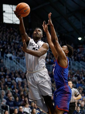 Butler Bulldogs forward Kelan Martin (30) puts up a shot around DePaul Blue Demons guard Eli Cain (11) in the first half of their game at Hinkle Fieldhouse Saturday, Feb 3, 2018. The Butler Bulldogs defeated the DePaul Blue Demons 80-57.