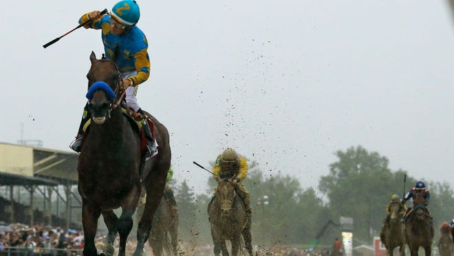 Jockey Victor Espinoza, left, celebrates aboard American Pharoah after winning the 140th Preakness Stakes horse race at Pimlico Race Course, Saturday, May 16, 2015, in Baltimore.