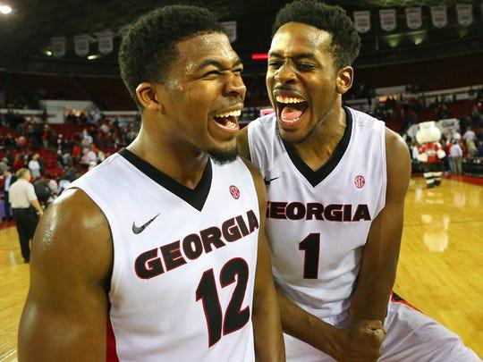 Georgia's Kenny Gaines and Yante Maten, right, celebrate