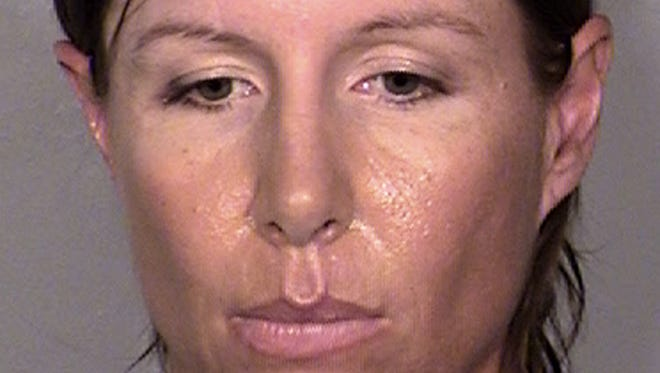 This image provided by the Las Vegas Metropolitan Police Department shows Alison Ernst, who was arrested April 10, 2014, in connection with an incident involving throwing a shoe at Former Secretary of State and Former First Lady Hillary Clinton.